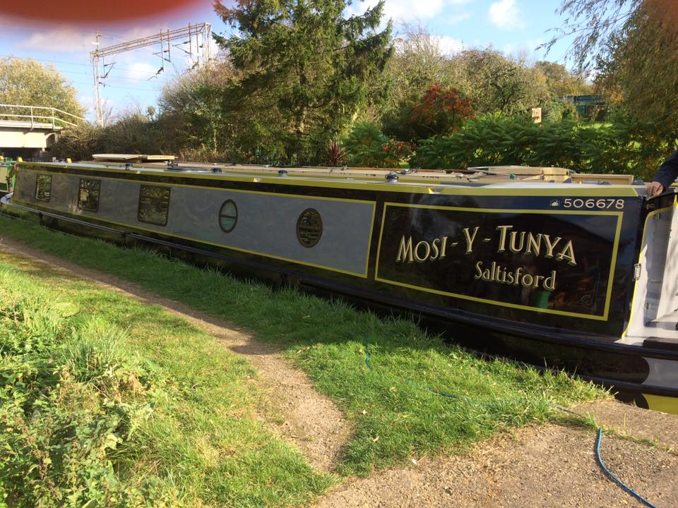 Mosi-Y-Tunya Boat Paint Job